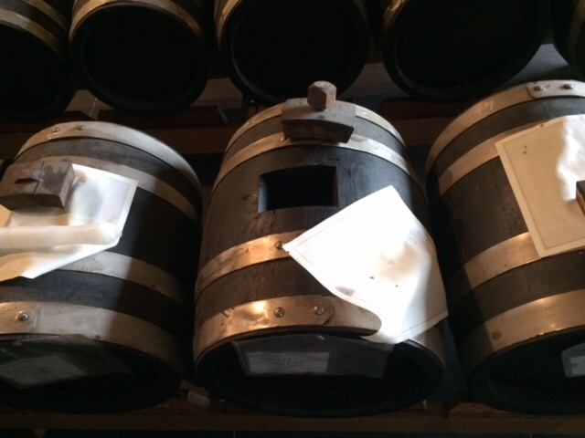 balsamic vinegar of modena in battery of barrels