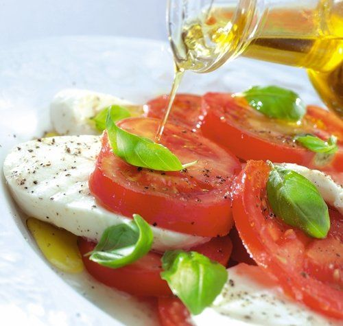 Olive oil on Caprese salad