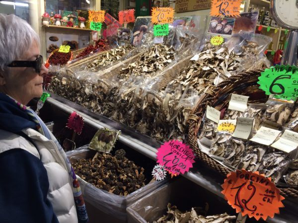 Sheila and mushrooms at Florence market.