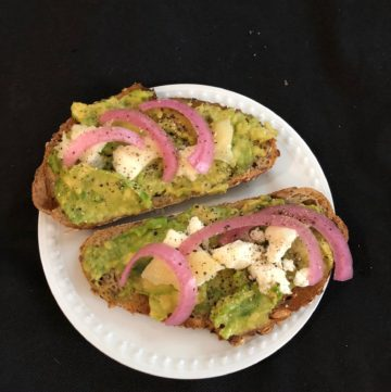 avocado toast with feta and pickled onion